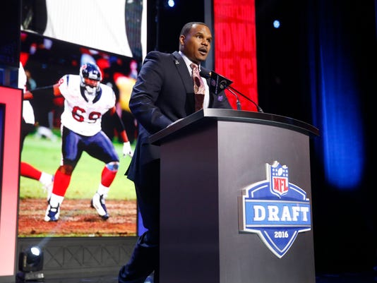 Former Walter Payton Men of the Year Chester Pitts announces that the Houston Texans selects Ohio State's Braxton Miller as the 85th pick in the third round of the 2016 NFL football draft, Friday, April 29, 2016, in Chicago. (AP Photo/Charles Rex Arbogast)