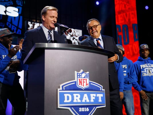 NFL Commissioner Roger Goodell introduces former NFL player Dick Butkus before Butkus announces that the Chicago Bears selects Kansas State's Cody Whitehair as the NUMBER pick in the second round of the 2016 NFL football draft, Friday, April 29, 2016, in Chicago. (AP Photo/Charles Rex Arbogast)