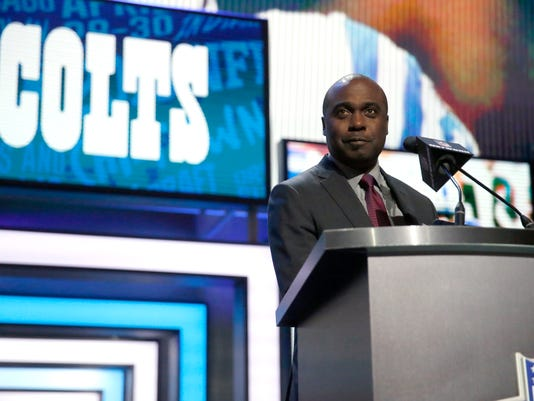 Former NFL player Marshall Faulk announces that the Indianapolis Colts selects Clemson's T.J. Green as the 57th pick in the second round of the 2016 NFL football draft, Friday, April 29, 2016, in Chicago. (AP Photo/Charles Rex Arbogast)