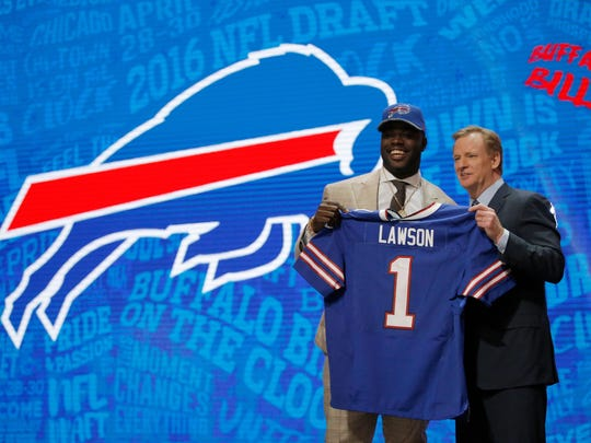 Shaq Lawson of Clemson holds up a jersey with NFL Commissioner