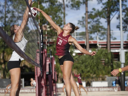 FSU's Jace Pardon tries to spike the ball past College of Charleston's Kayla Tronick in the final round of the FSU Beach Invitational earlier this season.