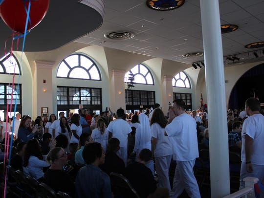 Nursing graduates file in to the Ocean City Music Pier at the start of the pinning ceremony.