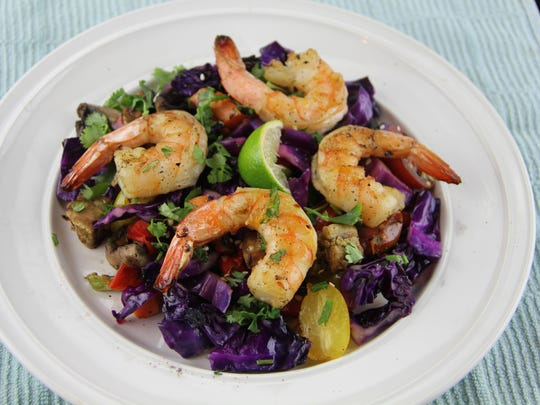 Grilled shrimp and vegetable salad with Asian dressing adds a kiss of summer by tossing the veggies on the barbecue.