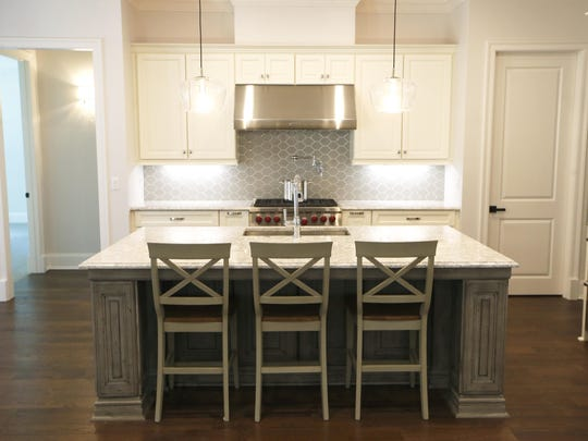 A kitchen by Kessler Construction at the recent Parade of Homes showcase. If you prefer a less cluttered kitchen environment, remove some of your decorative accessories and pare down counter top appliances.