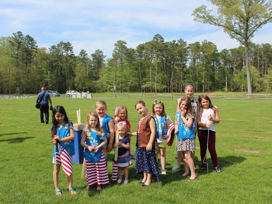 Members of Girl Scout troop 11013 pose for a picture
