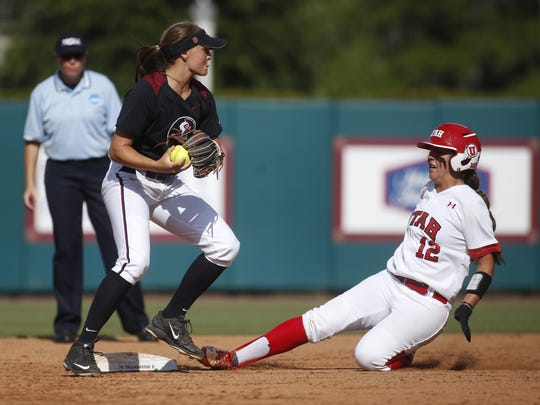 FSU's Cali Harrod tags second base to get Utah's Shelby Pacheco out during their Super Regional game at JoAnne Graf Field on Saturday. FSU went on to win 3-0, and are headed to the Women's College World Series in Oklahoma City.