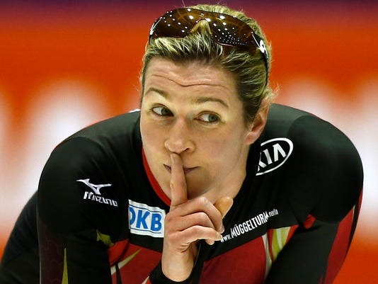FILE - A Friday, March 11, 2016 photo from files showing Germany's Claudia Pechstein as she motions for silence for the start of the next pair of skaters after her women's 3,000 meter race of the Speedskating World Cup final at Thialf ice rink in Heerenveen, Netherlands. The status and fairness of international sports' highest court is judged Tuesday, June 7, 2016,  when a potentially landmark verdict is announced in Germany. The Court of Arbitration for Sport is not even a formal party in a quest by Claudia Pechstein, a five-time Olympic champion speedskater, to get 4.4 million euros ($5 million) in compensation from the International Skating Union which banned her in 2009 for blood doping. (AP Photo/Peter Dejong, File)
