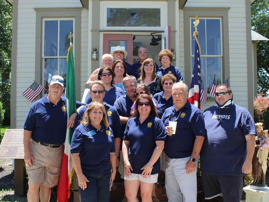 Members of the Hammonton Lions Club pose on the steps of the Historical Society during Sunday in the Park. The Lions Club helped to organize the event.