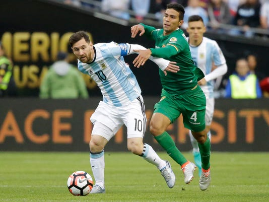 Argentina's Lionel Messi, left, and Bolivia's Diego Bejarano fight for the ball during a Copa America Centenario Group D soccer match, Tuesday, June 14, 2016, at CenturyLink Field in Seattle. (AP Photo/Ted S. Warren)