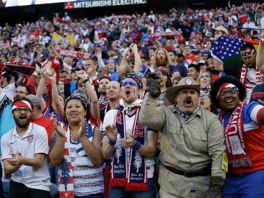 Fans of United States celebrate at the end a Copa America Centenario quarterfinal soccer match against Ecuador, Thursday, June 16, 2016 at CenturyLink Field in Seattle. United States won 2-1. (AP Photo/Elaine Thompson)