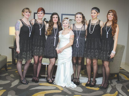 The bridesmaids in the wedding of Ashley Rodichok and Brandon Megahan: from left, Kristyne McDonough, Tayler Sweetman, Heather Williams, the bride, Julia Kogut, Sierra Figuero and sister-in-law Ashley Megahan.
