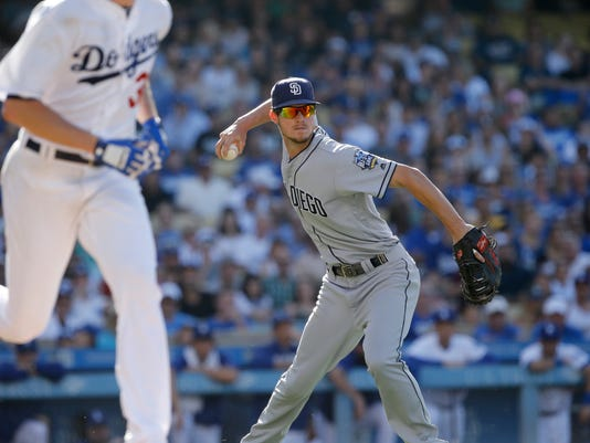 San Diego Padres first baseman Wil Myers, right, throws out Los Angeles Dodgers' Brandon McCarthy, left, on a bunt attempt during the fourth inning of a baseball game in Los Angeles, Saturday, July 9, 2016. (AP Photo/Alex Gallardo)
