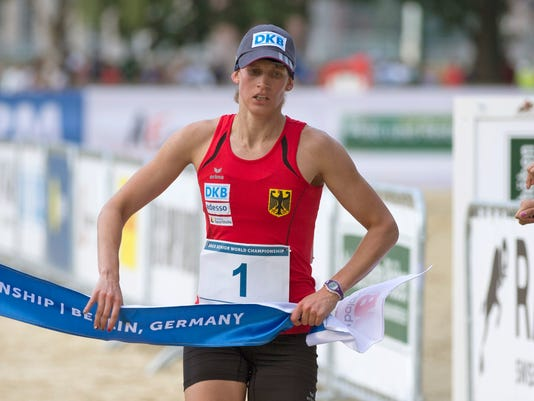 FILE - A Saturday, July 4, 2015 photo from files showing Lena Schoneborn of Germany as she crosses the line to win the women's combined competition of the Modern Pentathlon World Championships in Berlin, Germany. Schoneborn, the 2008 Olympic champion and 2015 World champion is one to watch at the Olympics in Rio de Janeiro along with Asadauskaite of Lithuania. (AP Photo/Axel Schmidt, File)