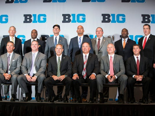 Coaches gather for a group photo Tuesday, July 26, 2016, during the Big Ten football media days in Chicago. Seated from left are Ohio State coach Urban Meyer, Northwestern coach Pat Fitzgerald, Michigan State coach Mark Dantonio, Indiana coach Kevin Wilson, Maryland coach D.J. Durkin and Rutgers coach Chris Ash. Standing are, from left, Iowa coach Kirk Ferentz, Purdue coach Darrell Hazell, Michigan coach Jim Harbaugh, Penn State coach James Franklin, Minnesota coach Tracy Claeys, Illinois coach Lovie Smith and Wisconsin coach Paul Chryst. (Joe Hermitt/PennLive.com via AP)