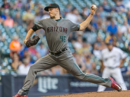 Arizona Diamondbacks' Patrick Corbin pitches to a Milwaukee Brewers batter during the first inning of a baseball game Tuesday, July 26, 2016, in Milwaukee. (AP Photo/Tom Lynn)