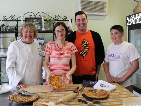 Renee Krell (holding pie) was the winner of the Peach Pie contest ,which was held on Saturday during the Peach Party. She stands with judges (left to right) Kelly McClay, dean of the Academy of Culinary Arts at Atlantic Cape Community College, J.T Murtagh and Ben Silvesti, 12.