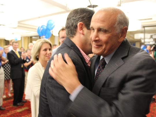Bruce Lisman hugs a supporter at the Burlington Hilton after making his concession speech.