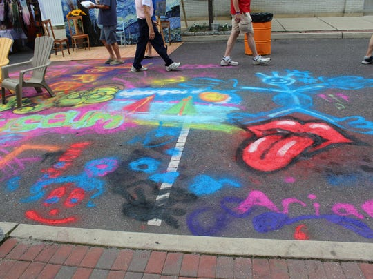 Some of the street art that had been created along Second St. during the Fringe Festival on Saturday.