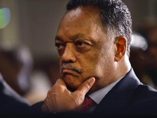 Rev. Jesse Jackson listens as Democratic vice presidential candidate Sen. Tim Kaine, D-Va., speaks to the Progressive National Baptist Convention in New Orleans, Thursday, Aug. 11, 2016. (AP Photo/Gerald Herbert)