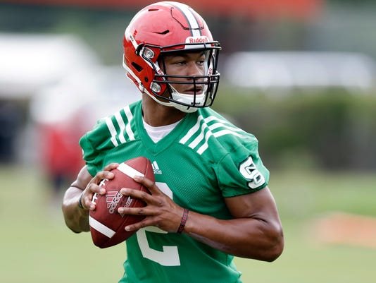 In this photo taken Monday, Aug. 1, 2016 North Carolina State quarterback Jalan McClendon looks to pass during an NCAA college football practice in Raleigh, N.C. (AP Photo/Gerry Broome)
