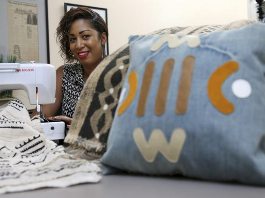 Terina McKinney works with Malian mud cloth for her fashion accessories and home decor items in Camden, N.J.