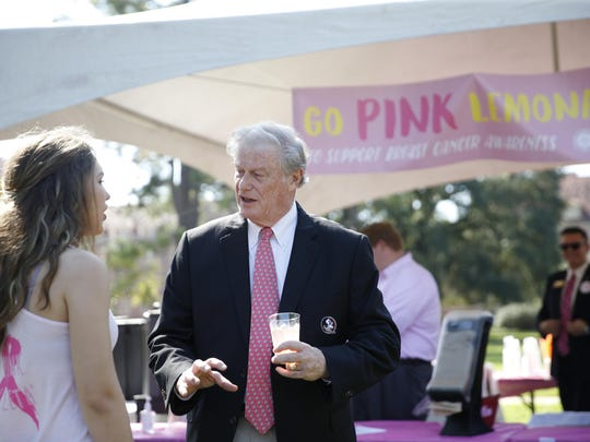 FSU President John Thrasher talks to student Emma McCoy at FSU's Go Pink lemonade stand on Landis Green last year. The stand was one of many established up around town for the start of breast cancer awareness month.