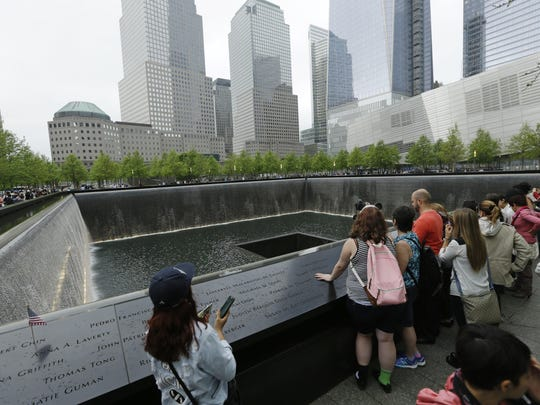 Patrons visit the pools at The 9/11 Memorial near the World Trade Center in New York.