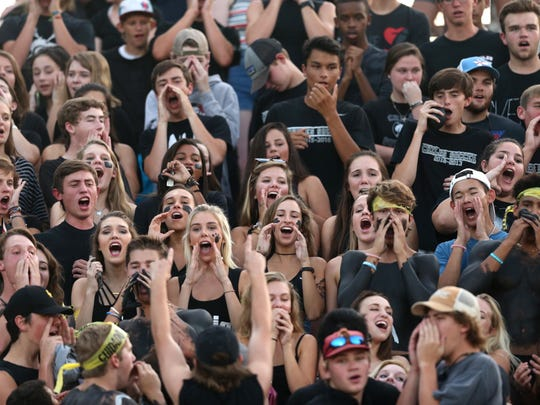 Chiles students cheer on their team during their Friday night game against NFC at Chiles High School.