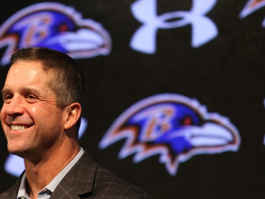 FILE - In this Jan. 7, 2016, file photo, Baltimore Ravens head coach John Harbaugh laughs during an NFL football news conference at the team's practice facility in Owings Mills, Md. Buffalo plays at Baltimore on Sunday. (AP Photo/Matt Hazlett, File)