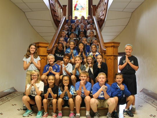 Madonna Academy fourth-graders planned an elementary rosary prayer service and showed their rosaries.