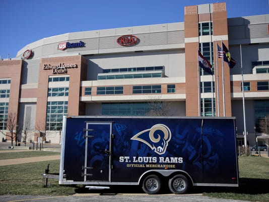 FILE - In this Jan. 13, 2016 file photo, a merchandise trailer sits outside the Edward Jones Dome, former home of the St. Louis Rams, in St. Louis. The start of a new NFL season is bringing no buzz of excitement in St. Louis, left without a team for the second time in three decades.(AP Photo/Jeff Roberson, File)