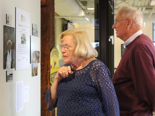 Bill and Cathy Parkhurst look at some of the photos on display at the new agriculture exhibit. Bill Parkhurst's family owned Parkhurst Farms and came to look at the sign on display from the farm.
