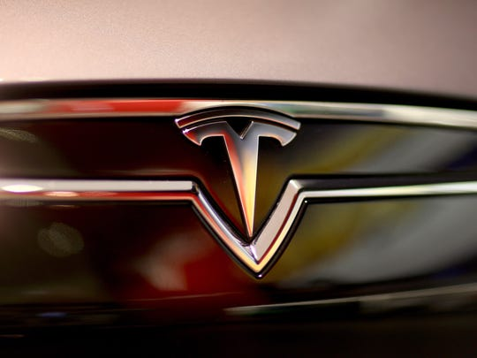 A Tesla Motors vehicle is seen on the showroom floor at the Dadeland Mall on February 19, 2014 in Miami.