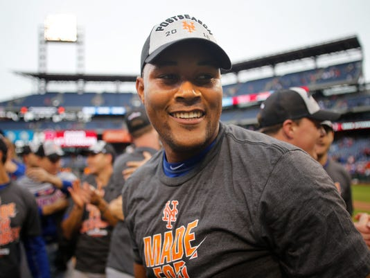 New York Mets relief pitcher Jeurys Familia walks off the field after the Mets defeated the Philadelphia Phillies 5-3 in a baseball game securing a wildcard playoff slot, Saturday, Oct. 1, 2016, in Philadelphia. (AP Photo/Laurence Kesterson)