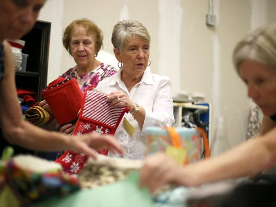 Lynne Corbett works with a team of volunteers at the storage space where they have created the A Bag for HOPE charity. Together they make and sell a variety of hand-crafted cloth items, with all profits benefiting the HOPE Community, a program under Tallahassee's Big Bend Homeless Coalition.