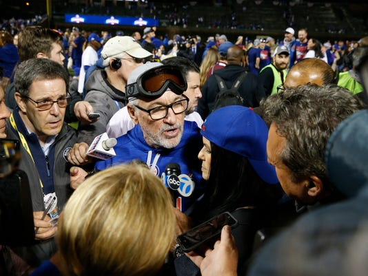 Chicago Cubs manager Joe Maddon (70) talks to reporters after Game 6 of the National League baseball championship series against the Los Angeles Dodgers, Saturday, Oct. 22, 2016, in Chicago. The Cubs won 5-0 to win the series and advance to the World Series against the Cleveland Indians. (AP Photo/Nam Y. Huh)