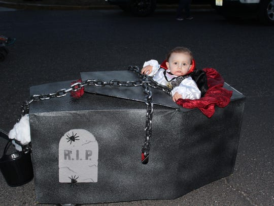 Glen Tyler Forman, 16 months, dressed as Dracula in his coffin for the parade's costume contest.