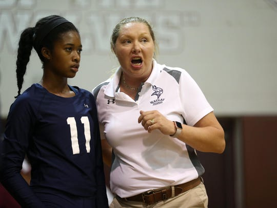 Maclay coach Erica Bunch talks to Isabella Choice during a timeout in their game against Chiles.