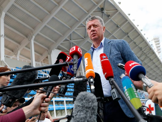 FILE - In this Thursday, July 21, 2016 file photo Dmitry Shlyakhtin, head of the Russian track and field federation, speaks to journalists prior to the Russian Athletics Cup, at Zhukovsky, outside Moscow, Russia.A year on from a damning report which described widespread, systematic doping, Russian track and field is hopeful of a way back. On Nov. 9, 2015, the World Anti-Doping Agency's independent commission unleashed a strongly worded, 323-page account of how Russian coaches and officials had colluded with athletes to use performance-enhancing drugs before and after the 2012 Olympics in London.  (AP Photo/Alexander Zemlianichenko, file)