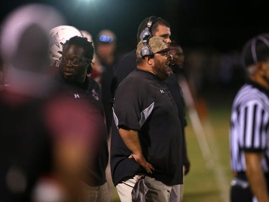Madison County head coach Mike Coe yells out to his team from the sidelines during their game against Rickards this season.
