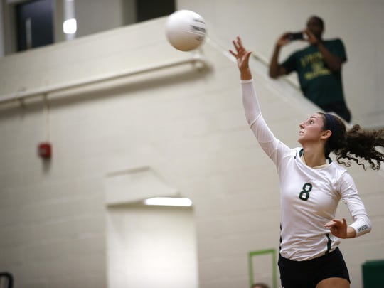 Lincoln's Madison Fitzpatrick serves the ball against Leon during a home game. Fitzpatrick signed a letter of intent Friday to play beach volleyball at FSU.