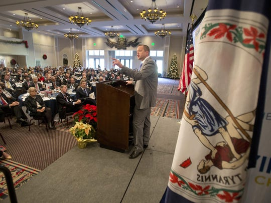 Republican candidate for Governor of Virginia, Corey Stewart, gestures as he speaks at the Virginia Chamber of Commerce Economic Summit at Colonial Williamsburg in Williamsburg on Friday.