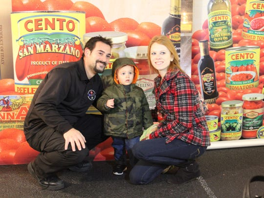 Nicholas Appice and his wife Candice with their son, Anthony, attended the 10th annual cutting of the cheese at Bagliani's Market in Hammonton.