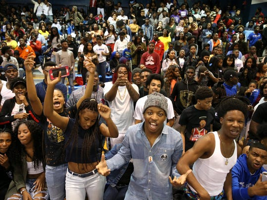 Students cheer on their team as Godby takes on Rickards' in basketball at Godby High School on Friday, Jan. 6, 2017.
