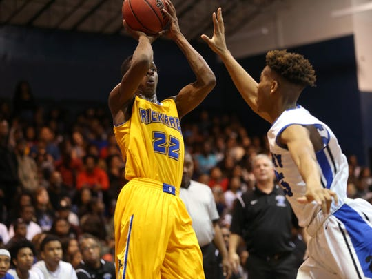Rickards' Darryl Jarman shoots a jumper over Godby's Jarvis Davis during their game at Godby High School on Friday, Jan. 6, 2017.