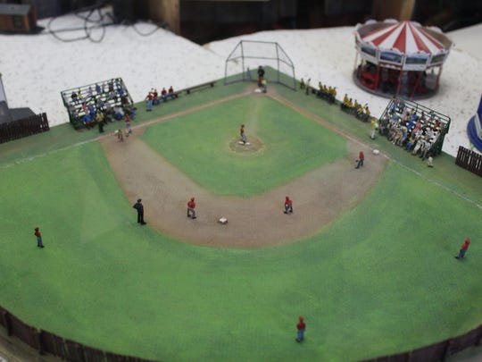A handcrafted baseball field is one of the little touches that the members of the Patcong Valley Model Railroad Club try to bring to their model recreations.