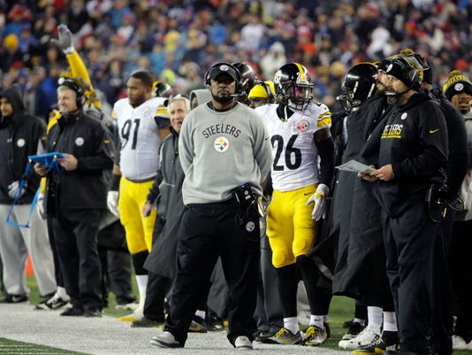 Pittsburgh Steelers head coach Mike Tomlin watches on the sideline beside Pittsburgh Steelers running back Le'Veon Bell (26) during the first half of the AFC championship NFL football game against the New England Patriots, Sunday, Jan. 22, 2017, in Foxborough, Mass. (AP Photo/Steven Senne)