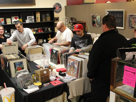 Visitors explore the records available at The Record Shop located in the Antique Marketplace.