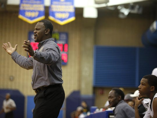 Lincoln coach Dimitric Salters yells out to his team during a 2015 Capital City Classic game.
