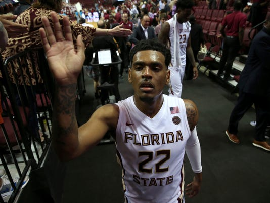Florida State's Xavier Rathan-Mayes high-fives fans after the team's 95-71 win over North Carolina State during an NCAA college basketball game Wednesday, Feb. 8, 2017., in Tallahassee, Fla. (Joe Rondone/Tallahassee Democrat via AP)